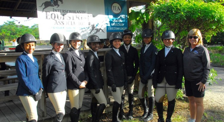 1. Eight riders participated in the Selection Trials to represent Team Bahamas in the first ever IEA International Invitational. L-R: Hannah D'Aguilar, Peyton Wong, Elle O'Brien, Alexis Neymour, Taylor Haines, Nicholas Astwood, Mila Sands and Maya Tilberg stand with Roxane Durant, President and Co-Founder of the U.S-based Interscholastic Equestrian Association (IEA)