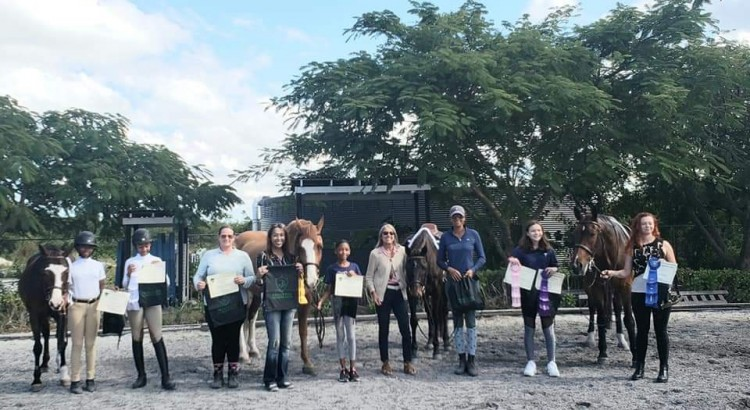 Princeton Equestrian League 2018-2019 Finalists and their equine partners proudly accept their awards. L-R: Trade Secret, Riley Harper (Finalist), Hannah D'Aguilar (Finalist), Kimberly Johnson (Trainer), Cathy Ramsingh-Pierre (Equestrian Bahamas President), Kokopelli's Dance, Sienna Tinker (Finalist), Linda Mancini (Show Judge), Casino Royale, Erika Adderley (Trainer), Elle O'Brien (Finalist), Valhalla, Sara Gottberg (Finalist).